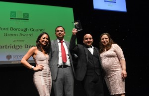Vincenza & Guy (right) receiving the award from the sponsor of the award Mohammad Yasin MP